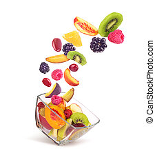 fruit salad ingredients in the air in a bowl, isolated on a...