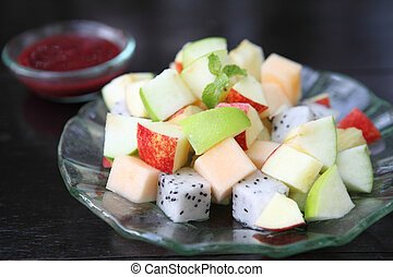fruit salad on wood background