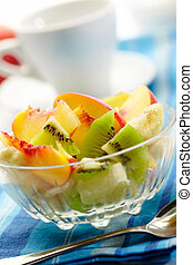 fruit salad with a cup on background