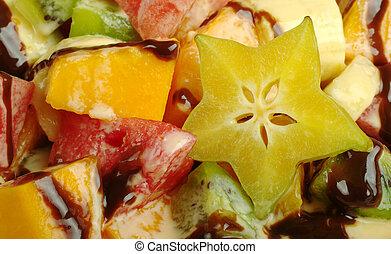 Fruit Salad with Chocolate Sauce (Close-up, Selective Focus)