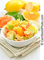 Fruit salad with cornflakes and fresh fruits