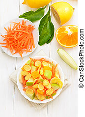 Fruit salad with cornflakes on white wooden table
