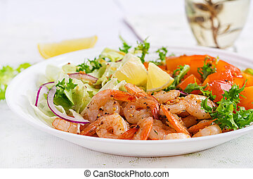 Fruit salad with fried prawns / shrimps, persimmon, red onion and lettuce in white bowls. Appetizers, snack, brunch. Healthy food.