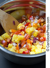 Fruit salad with pineapple, onion and tomato
