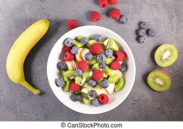 fruit salad with raspberry, blueberry, banana and kiwi