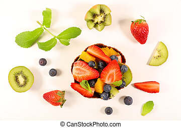 fruit salad with strawberry, blueberry, kiwi, orange and banana- top view on white background