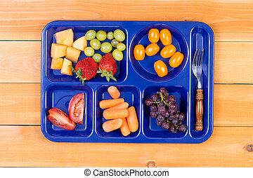 Fruit sampler in lunch tray with fork