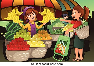 Fruit seller at the farmers market with a customer