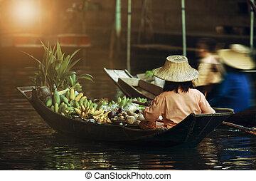 fruit seller sailing boat in dumneon saduak floating market ratchaburi thailand