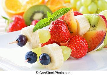 Fruit skewers - Ripe summer fruit in season on skewers