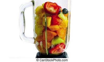 Fruit Smoothie Blended And Poured - Mixed fruits added to...