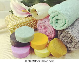 fruit soap and colorful bath towels spa and healthy...