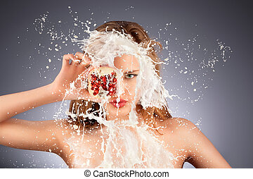 Fruit splash. - A portrait of a nude hot model with a...