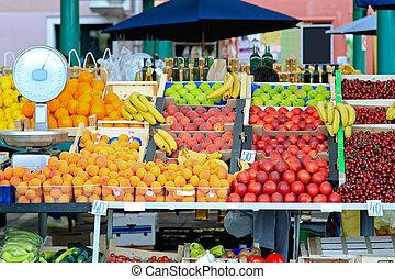Fresh organic fruits at farmers market stall