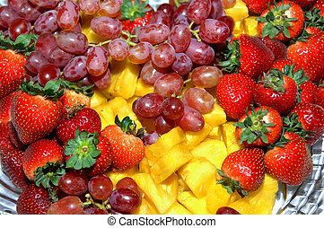 Fruit Tray - Glass tray holds variety of fruits including...