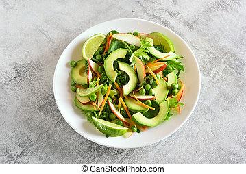 Fruit vegetable salad with avocado, green pea, greens, apple