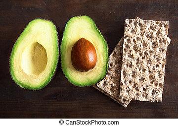 fruit., wholegrain, halves, bruine , houten, brood, knapperig, copyspace., ontbijt, schijfen, achtergrond., gezonde , twee, avocado