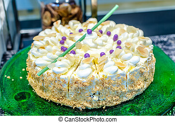 Fruitcake decorated with fruit and nut