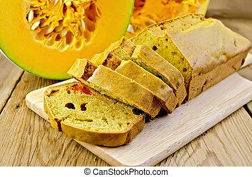 Fruitcake pumpkin with candied fruits on a board - Fruitcake...