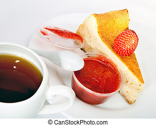 Fruitcake with a strawberry and a cup of tea