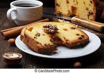 Fruitcake with raisin on wooden table still life