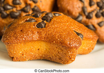 Fruitcakes with chocolate slices close up
