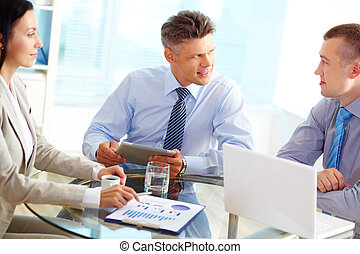 Fruitful discussion - Mature businessman being satisfied...