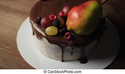 Fruits and berries on top of cake - Close-up view of cake...