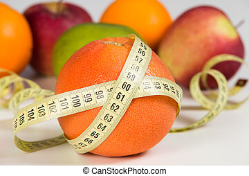 Fruits and measuring tape