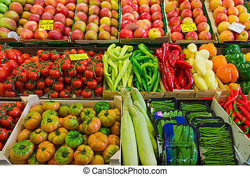 Fruits and vegetables at a farmers market.  Market stall with variety of organic vegetable