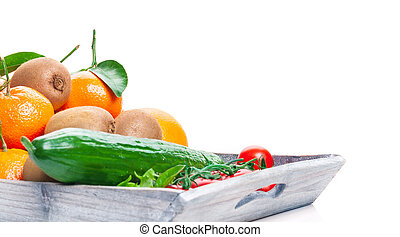 Fruits and vegetables on wooden tray