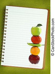 Fruits and vegetables painting on blank notebook page