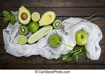 Fruits and vegetables with a glass of green smoothie