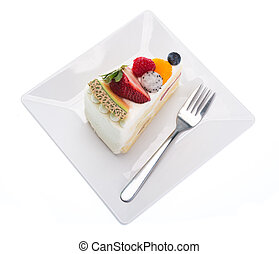 fruits cake on dish with fork isolated on white background