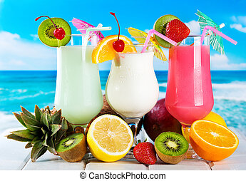 fruits cocktails on a beach