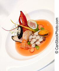 Octopus Terrine, poached scallop mousse, with tuna belly, steamed butter mussels, langoustine and tomato lobster fume