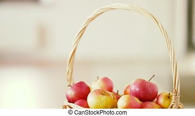 ripe apples in wicker basket on wooden table - fruits, food...