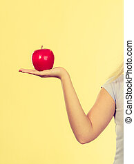 Woman hand holding delicious red apple
