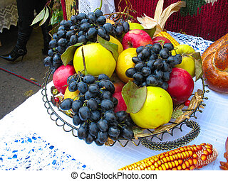 fruits grapes apples and corn on plate over a white canvas background