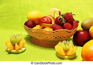 Fruits in a basket on a light green background