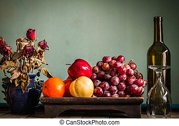 fruits in a tray on a table.