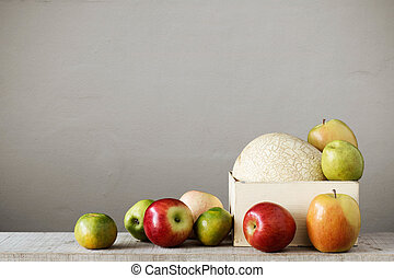 fruits in a tray on wooden.
