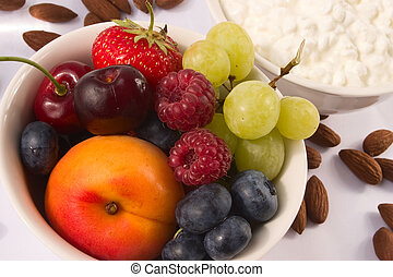 Bowl full of fruits and berries as a healthy source for snack or breakfast