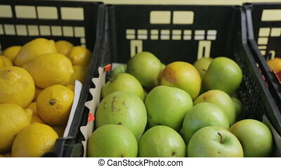 Fruits in boxes in greengrocer's shop