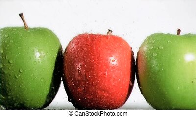 Fruits in line sprayed in super slo