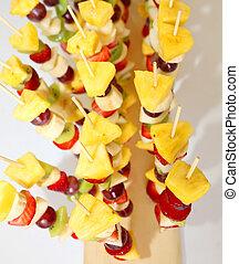 fruits in the skewers with pineapple strawberries kiwi banana