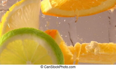 Fruits in water, citrus