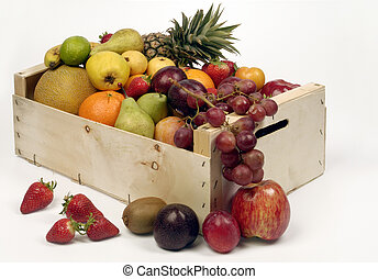 Fruits in woodden crate isolated on white, backdrop