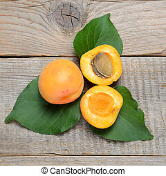 Fruits of apricot on wooden table