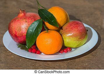 fruits on a white dish. background